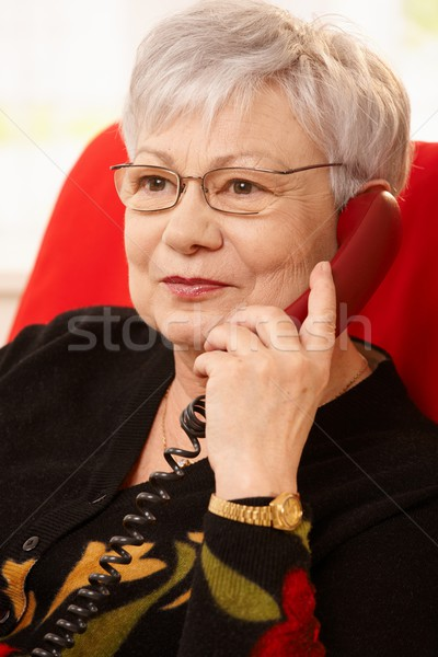 Closeup portrait of senior woman with phone Stock photo © nyul