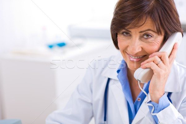 Stock photo: Doctor calling on phone