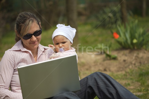 Mother uses a laptop Stock photo © nyul