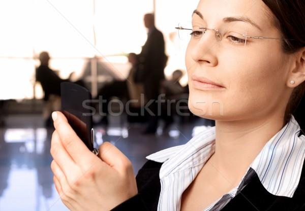Businesswoman dials on cellphone Stock photo © nyul