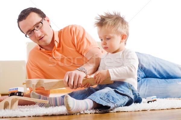 Vader kind spelen samen houten speelgoed Stockfoto © nyul