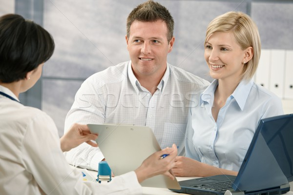 Doctor explaining medical diagnosis to patients Stock photo © nyul