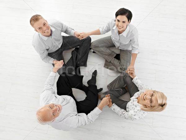 улыбаясь бизнес-команды глядя камеры сидят Сток-фото © nyul
