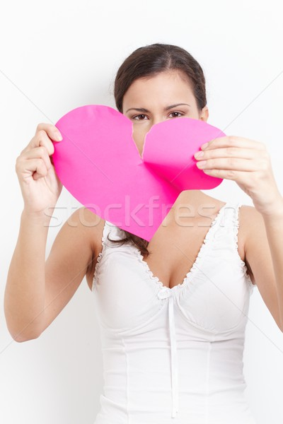 Stock photo: Young female with pink paper heart