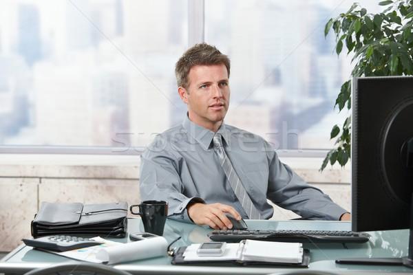 Stock fotó: üzletember · dolgozik · iroda · számítógép · üzlet · férfi