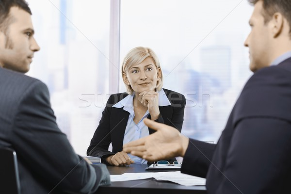 Businesswoman concentrating at meeting Stock photo © nyul