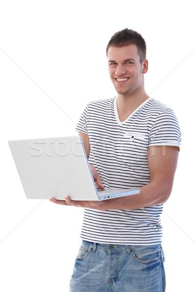 Stockfoto: Gelukkig · student · laptop · met · behulp · van · laptop · glimlachend