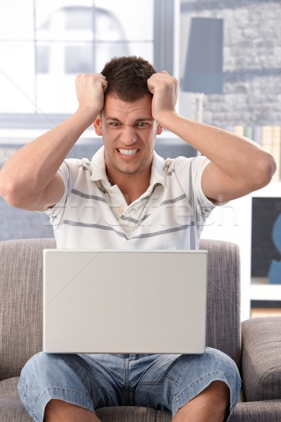 College student looking at laptop screen shocked Stock photo © nyul