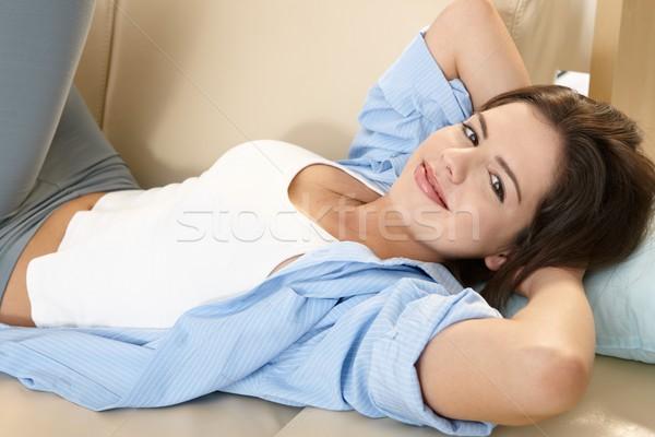 Stock photo: Pretty girl on sofa