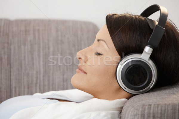 Young woman listening music Stock photo © nyul