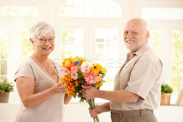 https://img3.stockfresh.com/files/n/nyul/m/66/624012_stock-photo-portrait-of-happy-senior-couple-with-flower.jpg