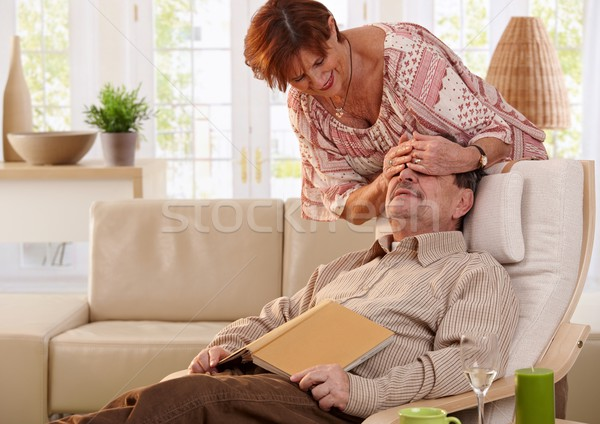Senior woman surprising her husband Stock photo © nyul