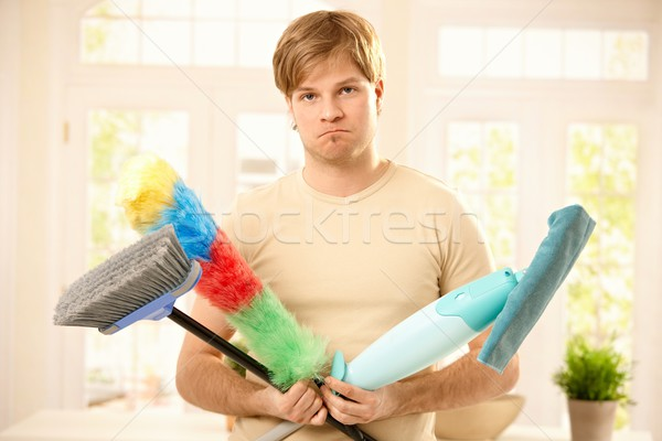 Stock photo: Upset guy with cleaning tools