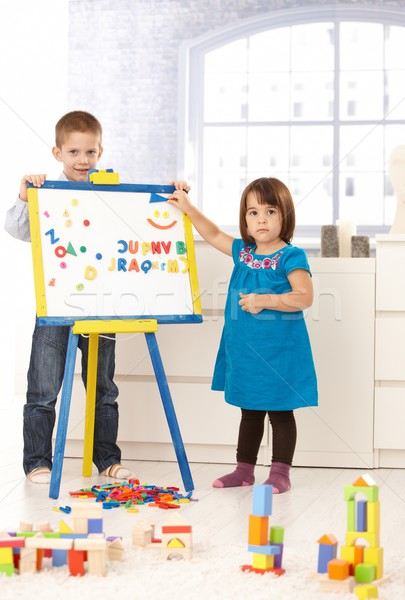 Creative small kids with drawing board Stock photo © nyul