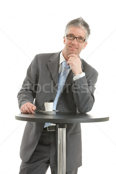 Businessman thinking at coffee table Stock photo © nyul