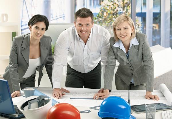 Sorridente arquiteto equipe em pé trabalho de escritório plano Foto stock © nyul