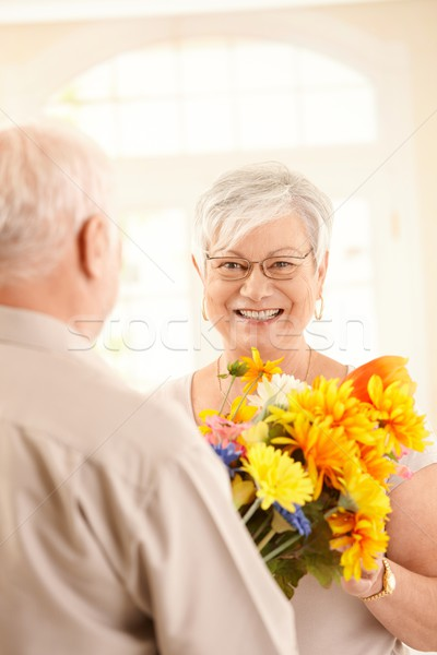 Laughing elderly woman getting bouquet Stock photo © nyul