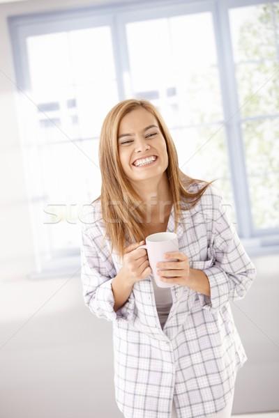молодые женщины смеясь счастливо Привлекательная женщина питьевой Сток-фото © nyul