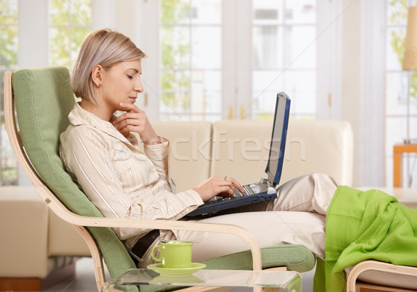 Woman working with computer at home Stock photo © nyul