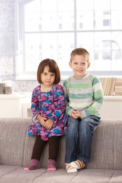 Souriant enfants séance canapé ensemble regarder Photo stock © nyul
