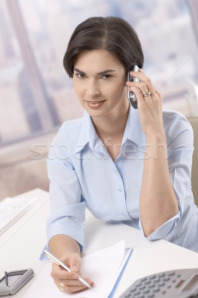 Portrait of businesswoman on phone call Stock photo © nyul