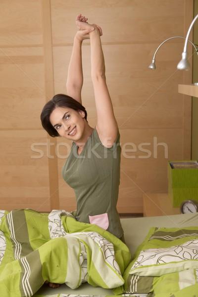 Sorrindo para cima sessão cama manhã Foto stock © nyul