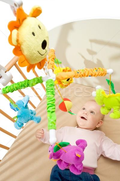 Feliz bebé jugando cama lado Foto stock © nyul