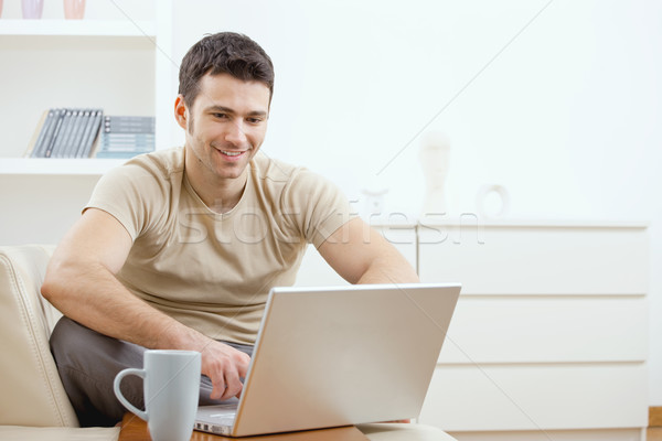 Stock photo: Happy man using computer