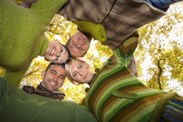 Portrait of happy friends with heads together Stock photo © nyul