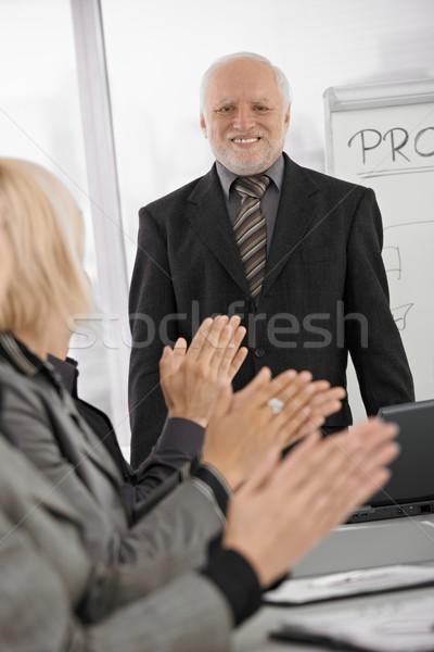 Team applauding senior businessman in office Stock photo © nyul