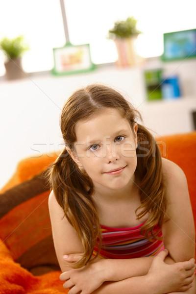 Cute dziewczynka kanapie portret posiedzenia uśmiechnięty Zdjęcia stock © nyul