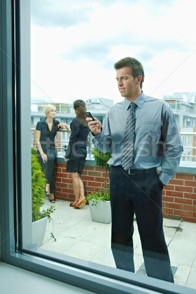 Businessman using mobile phone Stock photo © nyul