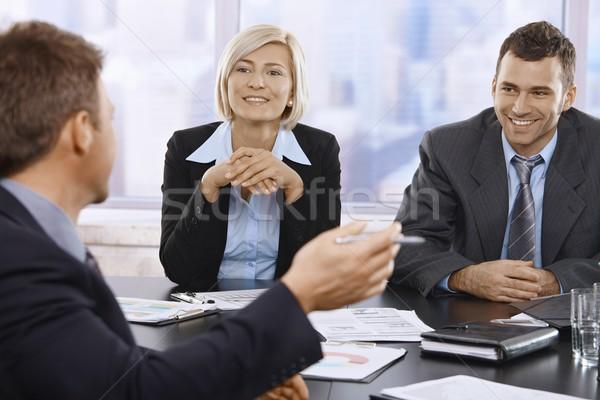 Stock fotó: Mosolyog · üzletemberek · megbeszélés · asztal · iroda · nő