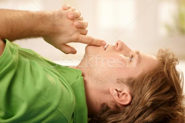 Man concentratie jonge man vloer handen samen Stockfoto © nyul