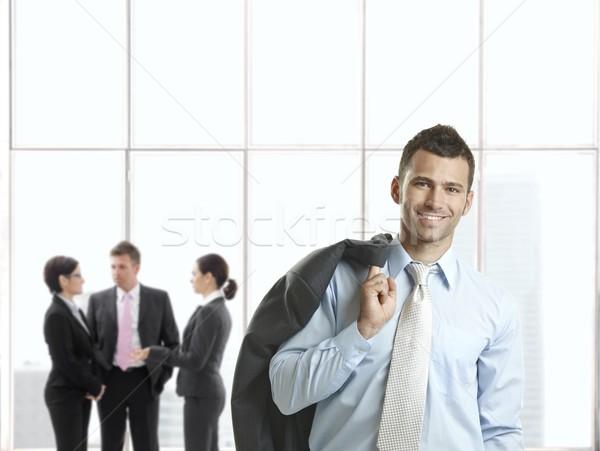 Szczęśliwy biznesmen biuro lobby uśmiechnięty kamery Zdjęcia stock © nyul