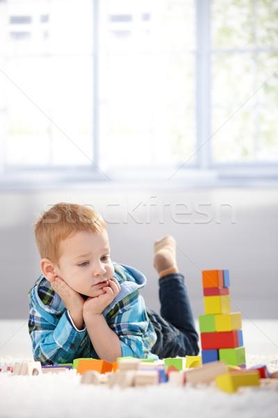 прелестный мало мальчика здании полу Сток-фото © nyul