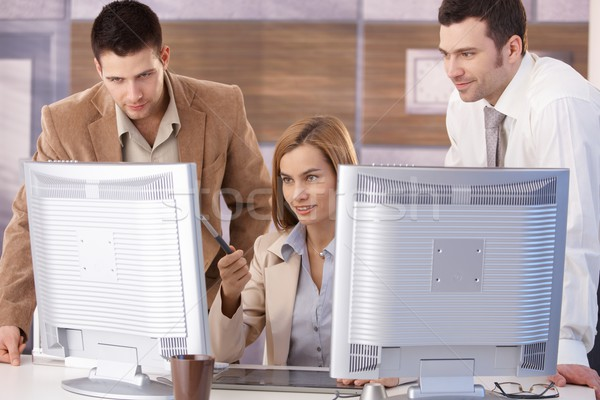 Stock photo: Young team learning computer graphic design