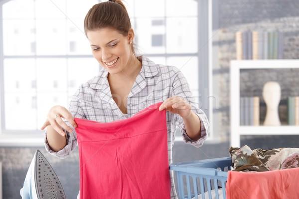 Happy woman doing laundry Stock photo © nyul