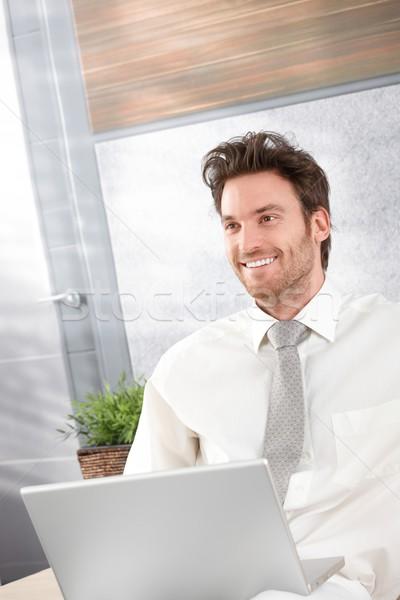Portrait of happy businessman Stock photo © nyul