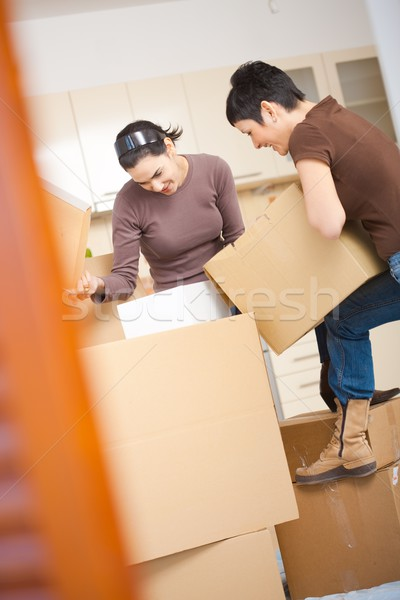 Women packing boxes Stock photo © nyul