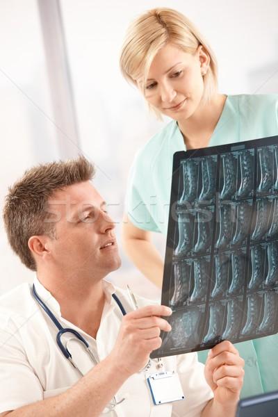 Doctor examining x-ray image with nurse Stock photo © nyul