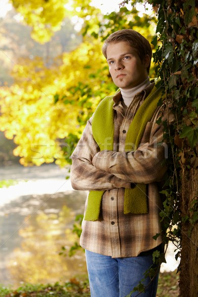 Handsome young man standing at tree outdoor Stock photo © nyul