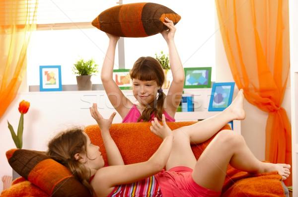 Kızlar oynama yastık kavgası öğrenciler kanepe oturma odası Stok fotoğraf © nyul