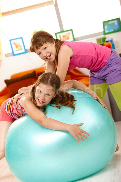 Kislányok játszik testmozgás labda otthon nevet Stock fotó © nyul