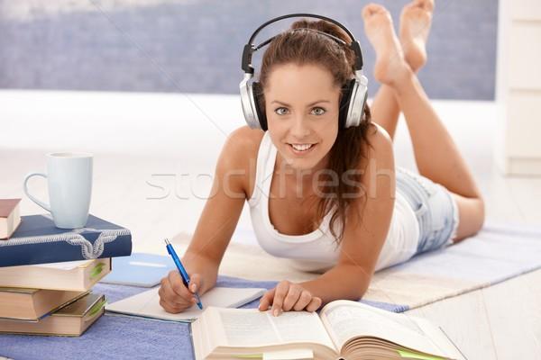 Csinos lány ír házi feladat fektet padló Stock fotó © nyul