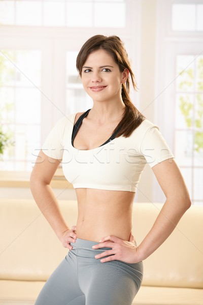 Smiling girl in sport suit Stock photo © nyul