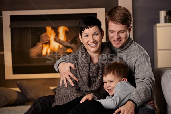 Boldog család otthon ül kanapé hideg tél Stock fotó © nyul