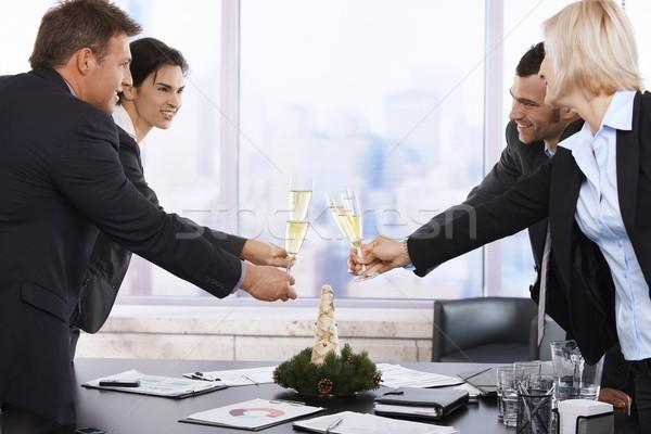 Stockfoto: Zakenlieden · vieren · nieuwjaar · toast · vergadering · tabel