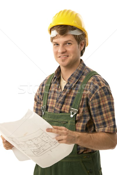 Handwerker halten Grundriss tragen Arbeitskleidung schauen Stock foto © nyul