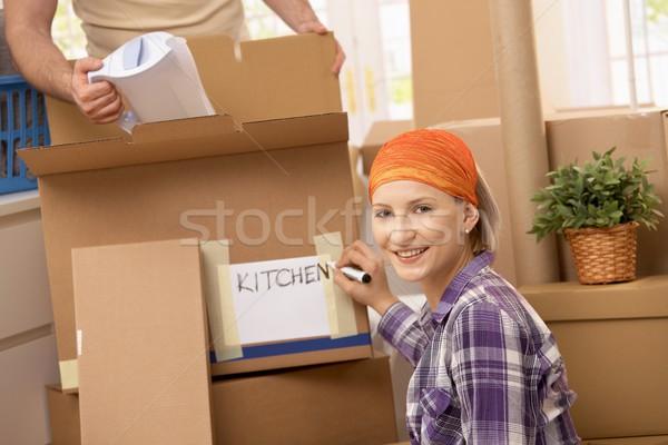 Pár mozog új hely férfi csomagol Stock fotó © nyul